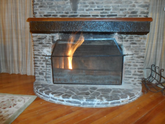 The fireplace in my cottage. This was not a decorative fire - it was desperately required.