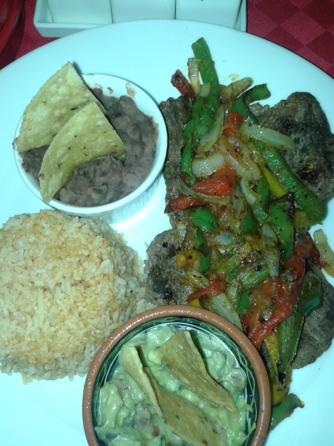 Tampiquena Style Beef - Njenva's meal. The rice was super dry and the beef quite bland....