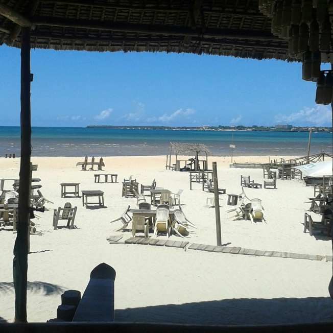 Tables and chairs on the beach waiting for customers who want to hang out by the ocean