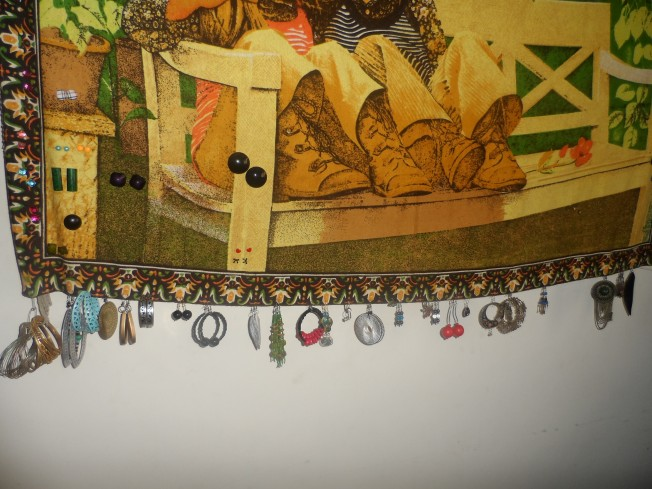 Earrings on a piece of cloth hung on a wall.....
