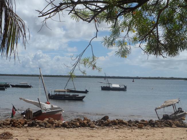 Boats at Lamu beach. On the horizon is Manda Island
