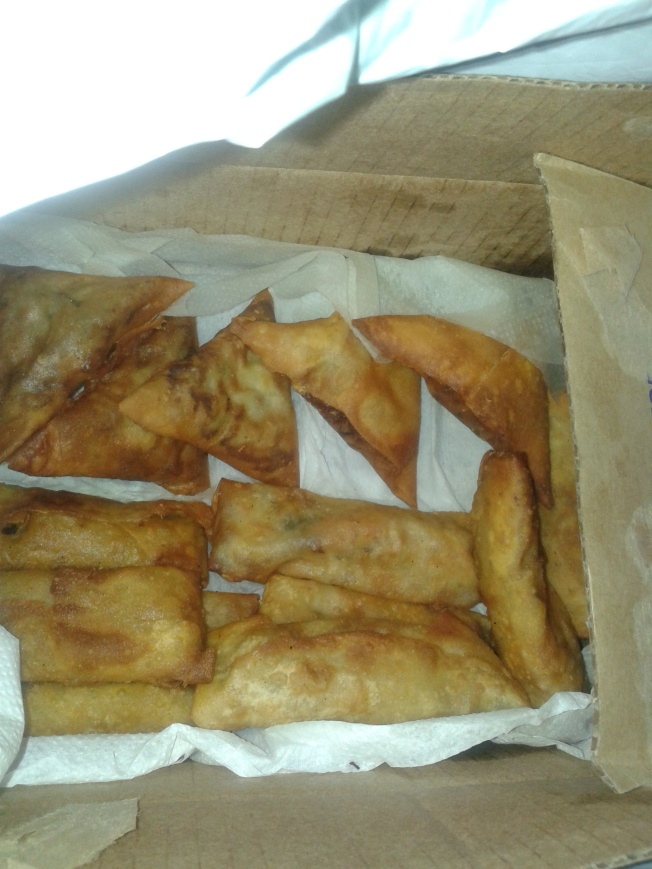 Samosas and spring rolls in a random carton lined with serviettes. The mahamris were in a black polythene bag.