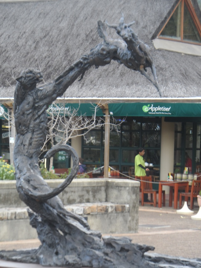 The entrance at Kirstenbosch National Botanical Garden. The predator and prey are made of wood... Very artistic