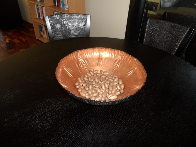 A beautiful copper centrepiece with real nuts