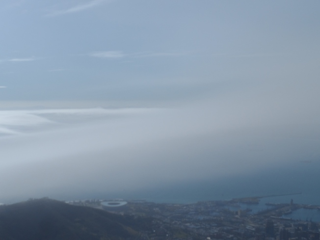 Cloudy Cape Town. The small circle at the bottom left is the Cape Town Green Point Stadium