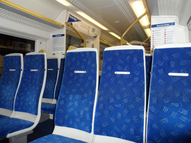 Inside the Gautrain. I had so much fun using the Gautrain. The last time I was in SA it was still being built so it was really cool using it to go places. It is so clean and ON TIME!!! 14 minutes from Sandton to OR Tambo. Seriously. By car it takes maybe an hour?!