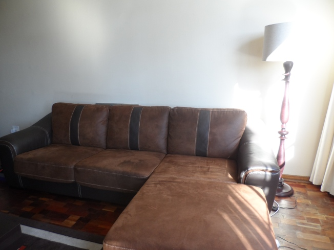 The L-Shaped couch that takes up most of the space in the sitting area. It directly faces the tv and is super comfortable