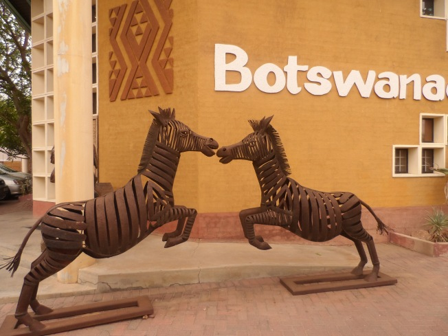 Sculpture of two zebras playing .....