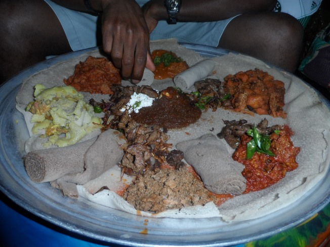 Injera base with fasting and non fasting dishes. Most menus had that description of toppings to describe heavy or light foods
