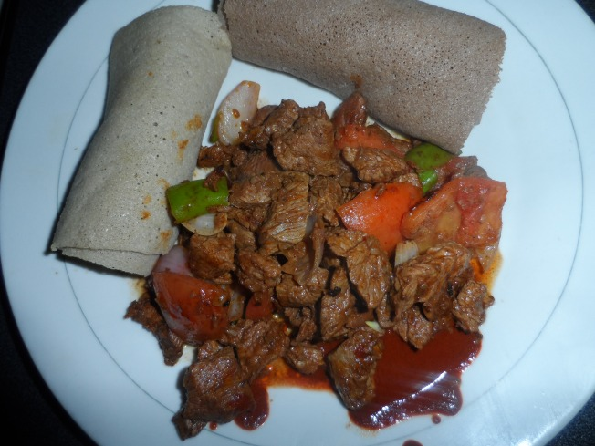 Polite injera with beef stew. White and brown injera